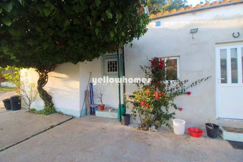 Large plot with partly renovated house with sea views near Loule